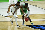 Purdue's Aaron Wheeler (1) and North Texas's Thomas Bell (13) battle for a loose ball during the first half of a first-round game in the NCAA men's college basketball tournament at Lucas Oil Stadium, Friday, March 19, 2021, in Indianapolis. (AP Photo/Darron Cummings)