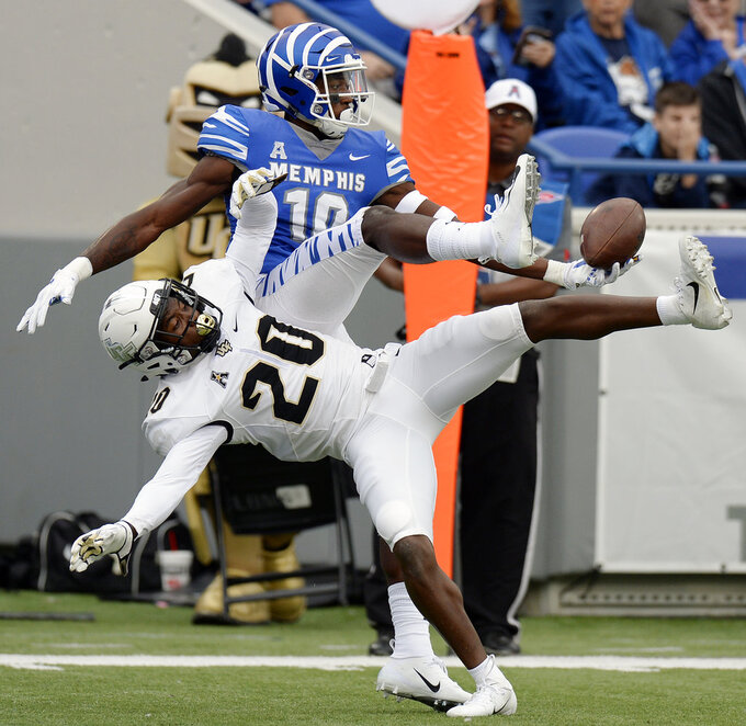 Central Florida defensive back Brandon Moore (20) breaks up a pass intended for Memphis wide receiver Damonte Coxie (10) during the first half of an NCAA college football game Saturday, Oct. 13, 2018, in Memphis, Tenn. (AP Photo/Mark Zaleski)