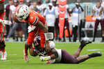 FILE - In this Oct. 5, 2019, file photo, Miami quarterback N'Kosi Perry (5) is sacked by Virginia Tech linebacker Rayshard Ashby during the second half of an NCAA college football game, in Miami Gardens, Fla. Ashby was selected to The Associated Press All-Atlantic Coast Conference football team, Tuesday, Dec. 10, 2019. (AP Photo/Lynne Sladky, File)
