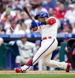 Philadelphia Phillies' Jean Segura cracks his bat on an RBI single during the fourth inning of a baseball game against the New York Yankees, Saturday, June 12, 2021, in Philadelphia. (AP Photo/Laurence Kesterson)