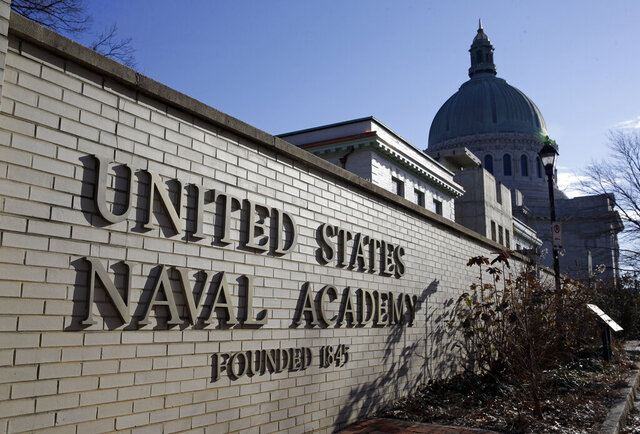 FILE - This Jan. 9, 2014 file photo shows a sign outside of an entrance to the U.S. Naval Academy campus in Annapolis, Md.  A federal judge in Baltimore has ruled that it is premature for her to decide whether to block the U.S. Naval Academy from expelling a midshipman for posting crude messages on social media. U.S. District Judge Ellen Hollander agreed Tuesday, Dec. 22, 2020, to dismiss Chase Standage's lawsuit and denied his request for a preliminary injunction allowing him to graduate from the academy.  (AP Photo/Patrick Semansky, File)