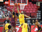 Maryland forward Galin Smith (30) blocks the shot of Minnesota guard Jamal Mashburn Jr., (4) during the first half of an NCAA college basketball game, Sunday, Feb. 14, 2021, in College Park, Md. (Kevin Richardson/The Baltimore Sun via AP)