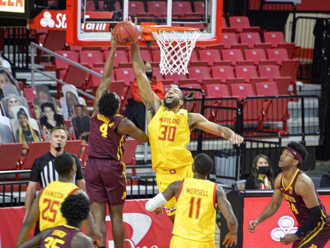Maryland forward Galin Smith (30) blocks the shot of Minnesota guard Jamal Mashburn Jr., (4) during the first half of an NCAA college basketball game, Sunday, Feb. 14, 2021, in College Park, Md. (Kevin Richardson/The Baltimore Sun via AP)