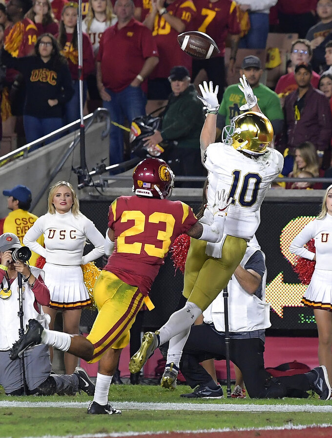 Notre Dame wide receiver Chris Finke, right, makes a touchdown catch as Southern California cornerback Jonathan Lockett defends during the first half of an NCAA college football game Saturday, Nov. 24, 2018, in Los Angeles. (AP Photo/Mark J. Terrill)