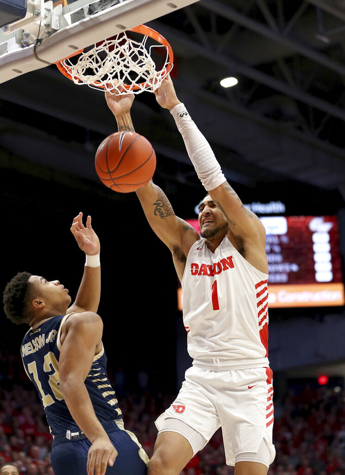 Dayton's Obi Toppin (1) dunks over George Washington's Jameer Nelson Jr (12) during the first half of an NCAA college basketball game Saturday, March 7, 2020, in Dayton, Ohio. (AP Photo/Tony Tribble)