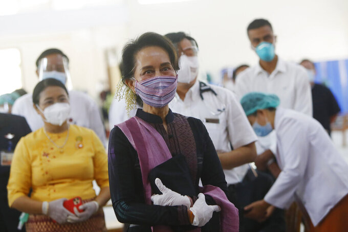 Myanmar leader Aung San Suu Kyi inspects and watches the vaccination processes to health workers at a hospital Wednesday, Jan. 27, 2021, in Naypyitaw, Myanmar. Health workers in Myanmar on Wednesday became the country's first people to get vaccinated against COVID-19, just five days after the first vaccine supply was delivered from India. (AP Photo/Aung Shine Oo)