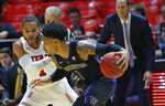 Washington guard David Crisp (1) drives around Utah guard Charles Jones Jr (1) during the second half of an NCAA college basketball game Thursday, Jan. 10, 2019, in Salt Lake City. (AP Photo/Rick Bowmer)