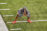 Clemson football player Isaiah Simmons warms up before he runs drills during NFL Pro Day Thursday, March 12, 2020, in Clemson, S.C. (AP Photo/Richard Shiro)