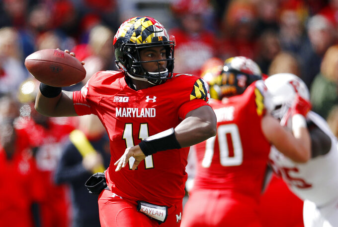 Maryland quarterback Kasim Hill throws to a receiver in the first half of an NCAA college football game against Rutgers, Saturday, Oct. 13, 2018, in College Park, Md. (AP Photo/Patrick Semansky)