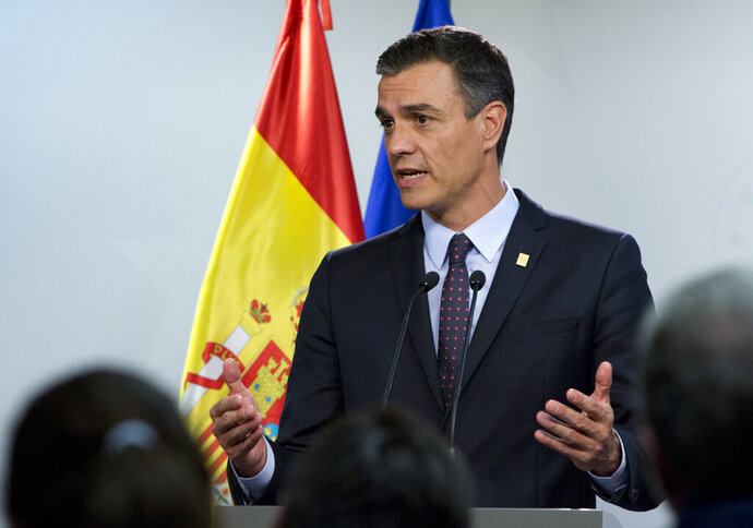FILE - In this file photo dated Tuesday, July 2, 2019, Spanish Prime Minister Pedro Sanchez speaks during a media conference during an EU summit in Brussels.  It is announced Friday July 19, 2019, that Sanchez is ready to create a coalition government with the United We Can party, so long as its leader, Pablo Iglesias, is not part of the future Cabinet. (AP Photo/Virginia Mayo, FILE)