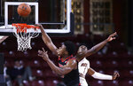 Louisville center Steven Enoch, left, misses a dunk against Boston College forward Jairus Hamilton, right, during the second half of an NCAA college basketball game in Boston, Wednesday, Feb. 27, 2019. (AP Photo/Charles Krupa)