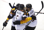 Germany's Leon Draisaitl, right, celebrates with teammates after scoring his sides fourth goal during the Ice Hockey World Championships group A match between Germany and Finland at the Steel Arena in Kosice, Slovakia, Tuesday, May 21, 2019. (AP Photo/Petr David Josek)
