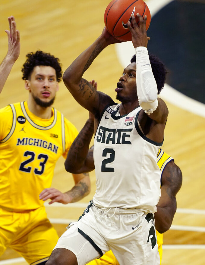 Michigan State guard Rocket Watts (2) attempts a shot during the second half of an NCAA college basketball game against Michigan, Sunday, March 7, 2021, in East Lansing, Mich. (AP Photo/Carlos Osorio)