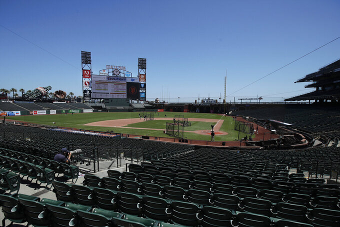 San Francisco Giants players work out at baseball practice at Oracle Park in San Francisco, Tuesday, July 14, 2020. (AP Photo/Jeff Chiu)