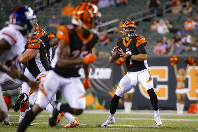 Cincinnati Bengals quarterback Jake Dolegala looks for a receiver during the second half of the team's NFL preseason football game against the New York Giants, Thursday, Aug. 22, 2019, in Cincinnati. (AP Photo/Frank Victores)