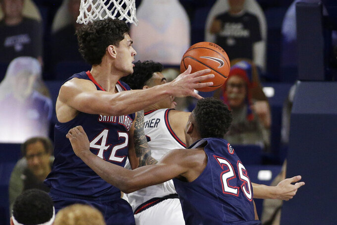 Saint Mary's forward Dan Fotu, left, forward Judah Brown, right, and Gonzaga guard Julian Strawther go after a rebound during the second half of an NCAA college basketball game in Spokane, Wash., Thursday, Feb. 18, 2021. (AP Photo/Young Kwak)