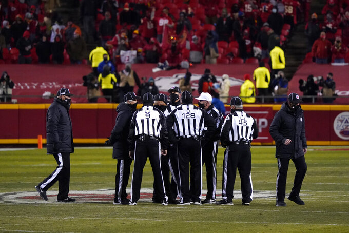 Officials huddle on the field during the second half of the AFC championship NFL football game between the Kansas City Chiefs and the Buffalo Bills, Sunday, Jan. 24, 2021, in Kansas City, Mo. (AP Photo/Jeff Roberson)
