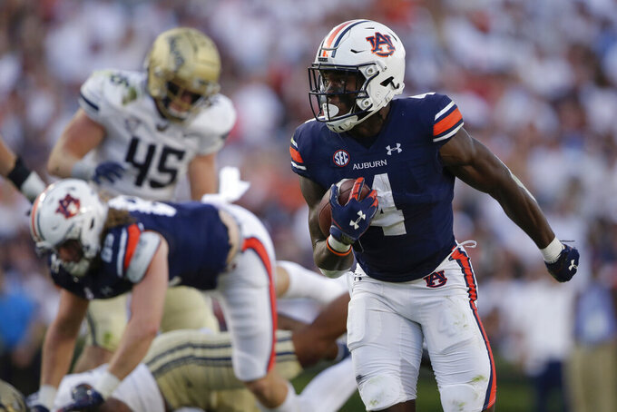 Auburn running back Tank Bigsby (4) carries the ball in for a touchdown against Akron during the first half of an NCAA college football game Saturday, Sept. 4, 2021, in Auburn, Ala. (AP Photo/Butch Dill)