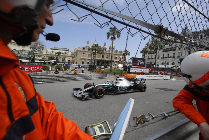 Mercedes driver Lewis Hamilton of Britain steers his car past the casino during the second practice session at the Monaco racetrack, in Monaco, Thursday, May 23, 2019. The Formula one race will be held on Sunday. (AP Photo/Luca Bruno)