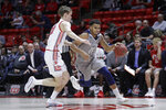UC Davis guard Caleb Fuller (11) drives as Utah forward Mikael Jantunen, left, defends during the first half of an NCAA college basketball game Friday, Nov. 29, 2019, in Salt Lake City. (AP Photo/Rick Bowmer)