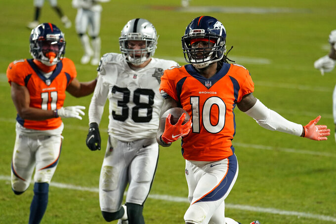 Denver Broncos wide receiver Jerry Jeudy (10) scores a 92-yard touchdown against the Las Vegas Raiders during the second half of an NFL football game, Sunday, Jan. 3, 2021, in Denver. (AP Photo/Jack Dempsey)