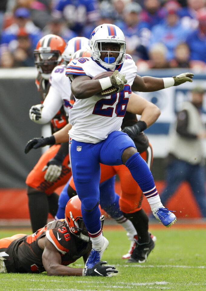 Buffalo Bills running back Devin Singletary (26) breaks a tackle by Cleveland Browns defensive back T.J. Carrie (38) during the first half of an NFL football game, Sunday, Nov. 10, 2019, in Cleveland. (AP Photo/Ron Schwane)