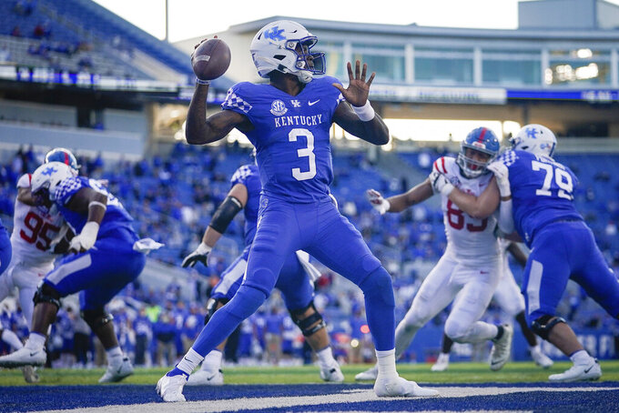 Kentucky quarterback Terry Wilson (3) passes the ball during the second half of an NCAA college football game against Kentucky, Saturday, Oct. 3, 2020, in Lexington, Ky. (AP Photo/Bryan Woolston)