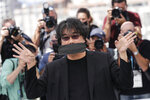 Director Bong Joon Ho poses for photographers at a photo call during the 74th international film festival, Cannes, southern France, Wednesday, July 7, 2021. (Photo by Vianney Le Caer/Invision/AP)