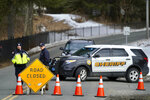 Berkshire County Sheriff Department officers close off the road Wednesday, March 13, 2019, in Sheffield, Mass., to a home where investigators work at the scene of a house fire that killed five people. (Ben Garver/The Berkshire Eagle via AP)