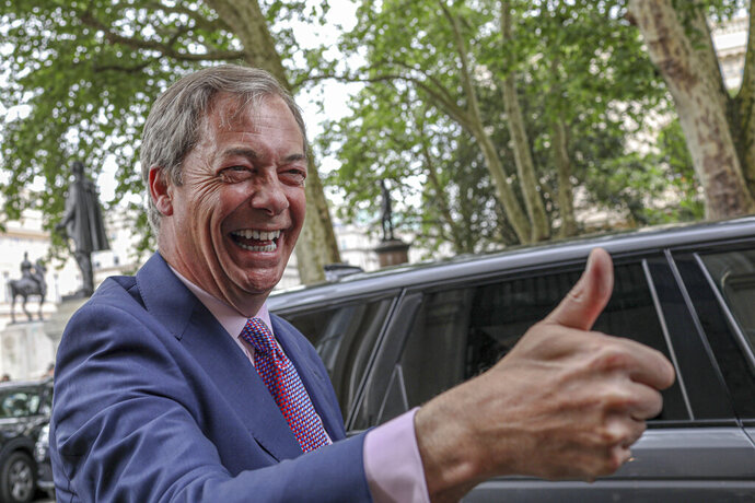 "FILE - In this Monday, May 27, 2019 file photo, Brexit Party leader Nigel Farage arrives at the party's HQ in London, prior to an event to mark the gains his party made in the European elections.  Farage, the self-declared ""pantomime villain"" of Brexit, told the Associated Press Tuesday Jan. 14, 2020, he is leaving the European Union's parliament in Strasbourg later this week with a sense of mission accomplished. (AP Photo/Vudi Xhymshiti, File)"