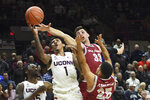 Connecticut's Christian Vital (1) and Saint Joseph's forward Taylor Funk (33) battle for the ball in the second half of an NCAA college basketball game Wednesday, Nov. 13, 2019, in Storrs, Conn. (AP Photo/Stephen Dunn)