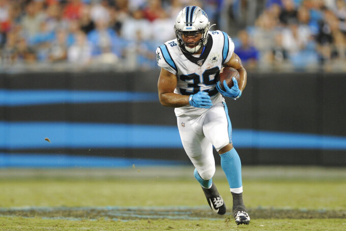 Carolina Panthers running back Reggie Bonnafon (39) runs against the Buffalo Bills during the first half an NFL preseason football game, Friday, Aug. 16, 2019, in Charlotte, N.C. (AP Photo/Mike McCarn)