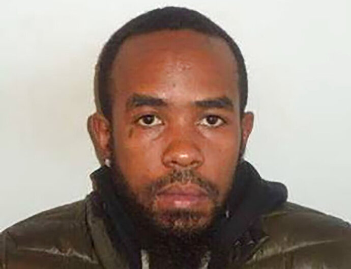 FILE- This undated photo provided by the Prince George's County Police Department shows Ricoh McClain. McClain, the suspect accused of fatally stabbing a man outside a Popeyes restaurant in Maryland has been arrested. A tweet Thursday morning, Nov. 14, 2019, from Prince George's County police confirmed the capture of McClain. He was wanted on murder charges in the death of Kevin Tyrell Davis.  (Courtesy of Prince George's County Police Department via AP, File)
