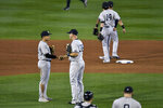 New York Yankees third baseman Gio Urshela, left, and first baseman Erik Kratz shake hands after the team's 12-1 win over the Toronto Blue Jays in a baseball game in Buffalo, N.Y., Tuesday, Sept. 22, 2020. (AP Photo/Adrian Kraus)