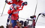 Washington Capitals right wing Brett Connolly (10) celebrates his goal during the second period of Game 3 of the NHL Eastern Conference finals hockey playoff series against the Tampa Bay Lightning, Tuesday, May 15, 2018 in Washington. (AP Photo/Nick Wass)