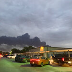 In this Tuesday, March 19, 2019 photo, shows smoke rising from a fire at the Intercontinental Terminals Company near the Carpenter Elementary School in Deer Park, Texas. Officials have lifted an order to remain indoors after several readings showed that the air quality had improved near a scorched petrochemical storage facility in suburban Houston. City officials in Deer Park lifted the order Thursday and reopened roads around the Intercontinental Terminals Company. But residents living near ITC say they're skeptical of what public officials are telling them. (Jeffrey Fountain via AP)