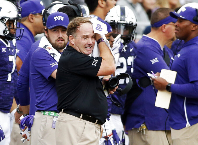 FILE - In this Saturday, Oct. 20, 2018, file photo, TCU head coach Gary Patterson wipes sweat from his forehead during the first half of an NCAA college football game against Oklahoma in Fort Worth, Texas. TCU faces Kansas State on Saturday (AP Photo/Brandon Wade, File)