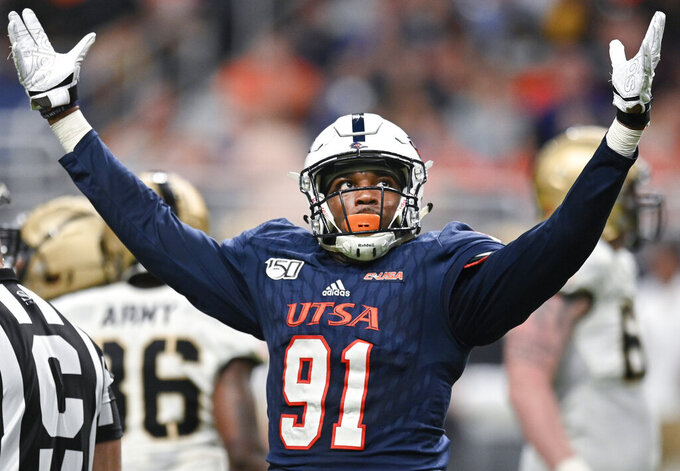 UTSA's Jarrod Carter-McLin celebrates a sack during the first half of an NCAA college football game against Army, Saturday, Sept. 14, 2019, in San Antonio. (AP Photo/Darren Abate)