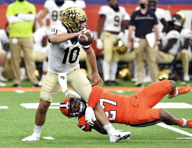 Syracuse linebacker Stefon Thompson (27) puts pressure on Wake Forest quarterback Sam Hartman (10) during an NCAA college football game Saturday, Oct. 31, 2020, in Syracuse, N.Y. (Dennis Nett/The Post-Standard via AP)