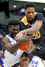 Arkansas-Pine Bluff's Chris Smith, right, and Pittsburgh's Eric Hamilton battle for a rebound during the first half of an NCAA college basketball game Thursday, Nov. 21, 2019, in Pittsburgh. (AP Photo/Keith Srakocic)
