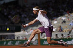 Stefanos Tsitsipas of Greece returns the ball to Germany's Alexander Zverev during their semifinal match of the French Open tennis tournament at the Roland Garros stadium Friday, June 11, 2021 in Paris. (AP Photo/Christophe Ena)