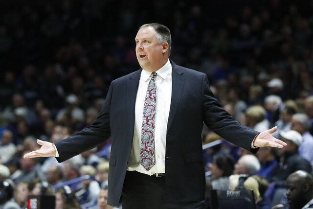 "FILE - In this Dec. 4, 2019, file photo, Green Bay head coach Linc Darner gestures during the first half of an NCAA college basketball game against Xavier in Cincinnati. Darner is out as the men's basketball coach at Green Bay after posting winning records in four of his five seasons on the job. Chancellor Michael Alexander confirmed the move Monday, May 18, 2020, saying in a statement that the university and coach ""have decided to part ways.""(AP Photo/John Minchillo, File)"