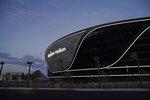 FILE - In this July 22, 2020, file photo, lights adorn Allegiant Stadium, new home of the Las Vegas Raiders football team, as it nears completion in Las Vegas. Officials in Nevada have declared