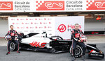 Kevin Magnussen, left, and Romain Grosjean unveil the Haas VF-20 ahead of the Formula One pre-season testing session at the Barcelona Catalunya racetrack in Montmelo, outside Barcelona, Spain, Wednesday, Feb. 19, 2020. (AP Photo/Joan Monfort)