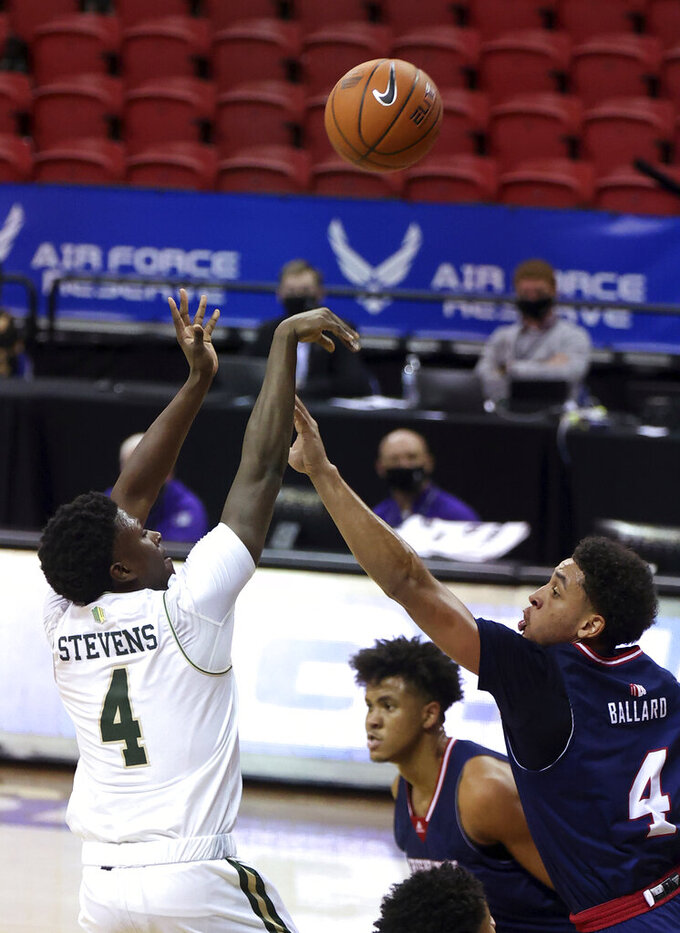 Colorado State guard Isaiah Stevens (4) shoots as Fresno State guard Junior Ballard (4) defends during the first half of an NCAA college basketball game in the quarterfinals of the Mountain West Conference men's tournament Thursday, March 11, 2021, in Las Vegas. (AP Photo/Isaac Brekken)