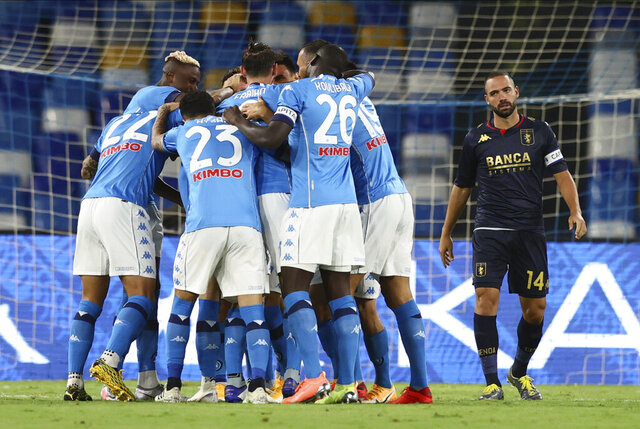 Napoli's players celebrate Piotr Zielinski's goal during the Serie A soccer match between Napoli and Genoa at the San Paolo Stadium in Naples, Italy, Sunday, Sept. 27, 2020. (Alessandro Garofalo/LaPresse via AP)