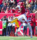 Indiana defensive back Jonathan Crawford (9) makes an interception during the first half of an NCAA college football game against Iowa, Saturday, Oct. 13, 2018, in Bloomington, Ind. (AP Photo/Doug McSchooler)