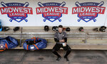 In this Monday, May 13, 2019 photo, Quad Cities River Bandits infielder Trey Dawson sits in the dugout before a Class-A Midwest League baseball game against the Cedar Rapids Kernels in Cedar Rapids, Iowa. Quad Cities will play at least 40 of their first 43 games away from their home stadium Modern Woodmen Park because of water issues caused by flooding from the nearby Mississippi River. (AP Photo/Charlie Neibergall)