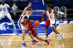 North Carolina State guard Shakeel Moore (2) drives past Saint Louis forward Marten Linssen (12) during the first half of an NCAA college basketball game, Thursday, Dec. 17, 2020, in St. Louis. (Laurie Skrivan/St. Louis Post-Dispatch via AP)