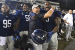 Georgia Southern head coach Chad Lunsford hugs offensive lineman Curtis Rainey, right, during the final moments of an NCAA college football game against Appalachian State, Thursday, Oct. 25, 2018, in Statesboro, Ga. Georgia Southern won 34-14. (AP Photo/John Amis)